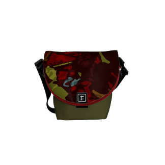 Colorful leaves and flowers against camouflage commuter bag