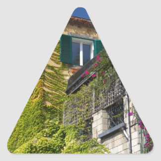 Colorful leaves on house triangle sticker