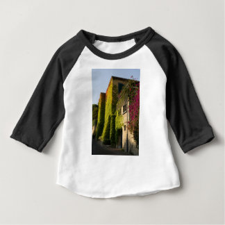 Colorful leaves on house walls baby T-Shirt