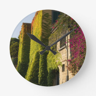 Colorful leaves on house walls round clock