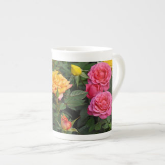 Colorful miniature roses tea cup
