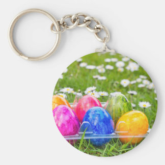 Colorful painted easter eggs in grass with daisies keychain