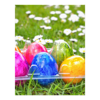 Colorful painted easter eggs in grass with daisies letterhead
