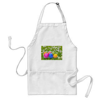 Colorful painted easter eggs in grass with daisies standard apron