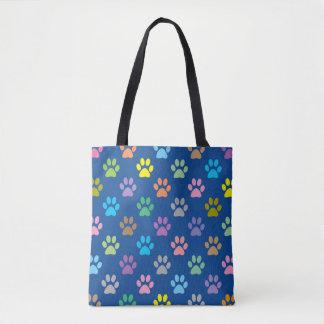 Colorful paw prints pattern tote bag