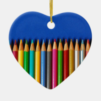 Colorful pencil crayons on blue background ceramic ornament