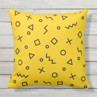 Colorful pillow with memphis hipster pattern