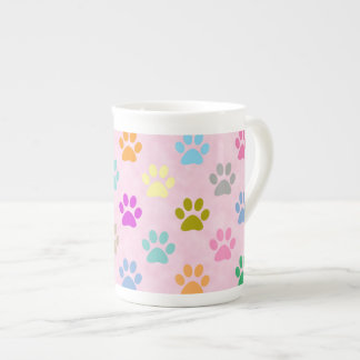Colorful puppy paw prints tea cup