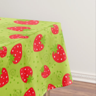Colorful red strawberry pattern on green tablecloth