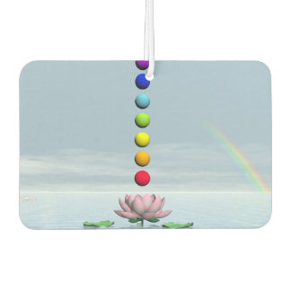 Colorful spheres for chakras upon beautiful lily f air freshener