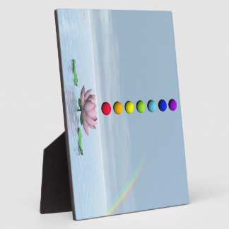 Colorful spheres for chakras upon beautiful lily f plaque