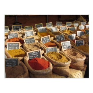 Colorful spices in jute bags at the local market postcard