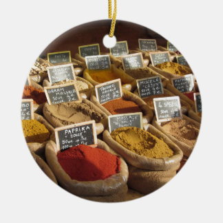 Colorful spices in jute bags at the local market round ceramic ornament