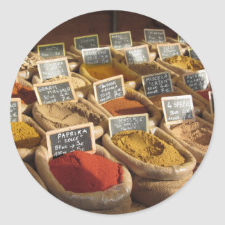 Colorful spices in jute bags at the local market round sticker