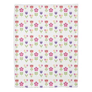 Colorful springtime flowers, on white duvet cover