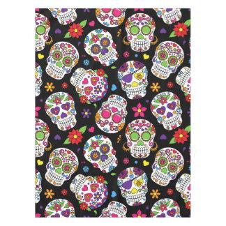 Colorful Sugar Skulls On Black Tablecloth
