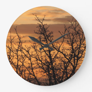 Colorful Sunset with tree silhouette Wall Clock
