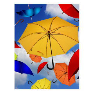 Colorful Umbrellas Floating in the Sky Postcard