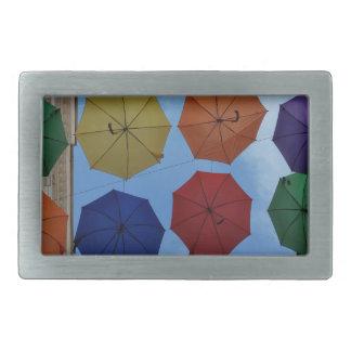Colorful umbrellas rectangular belt buckles