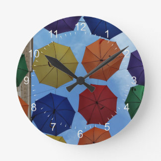 Colorful umbrellas round clock
