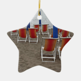Colorful wooden chairs at sand beach ceramic ornament