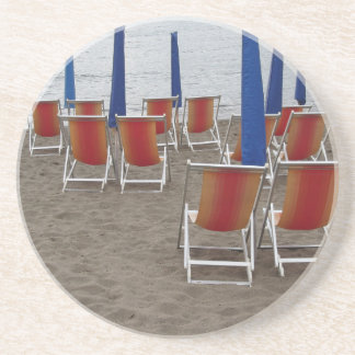 Colorful wooden chairs at sand beach coaster