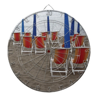 Colorful wooden chairs at sand beach dartboard