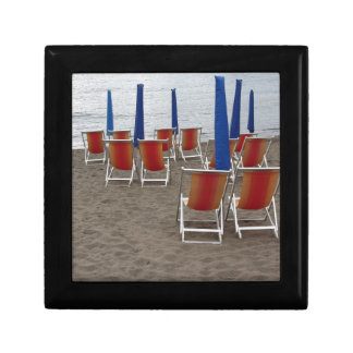 Colorful wooden chairs at sand beach gift box