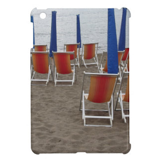 Colorful wooden chairs at sand beach iPad mini cases