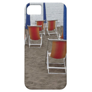 Colorful wooden chairs at sand beach iPhone 5 covers