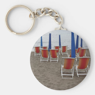 Colorful wooden chairs at sand beach keychain