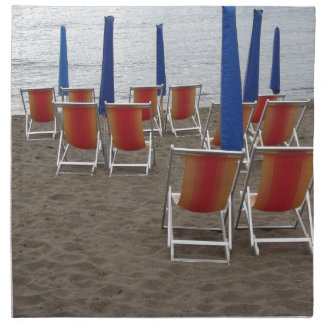 Colorful wooden chairs at sand beach napkin