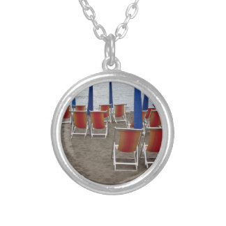 Colorful wooden chairs at sand beach silver plated necklace