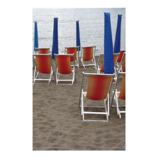 Colorful wooden chairs at sand beach stationery