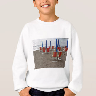 Colorful wooden chairs at sand beach sweatshirt