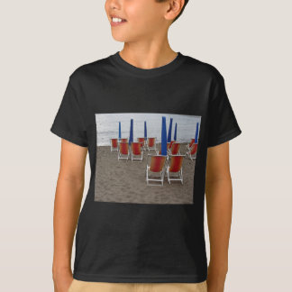 Colorful wooden chairs at sand beach T-Shirt