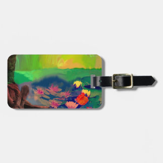 Colors invade the sky, the lilies cover the pond. luggage tag