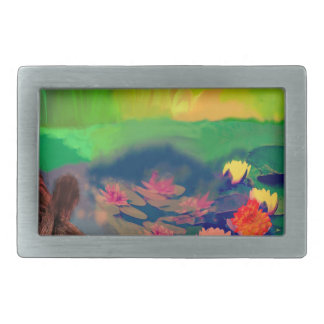 Colors invade the sky, the lilies cover the pond. rectangular belt buckle