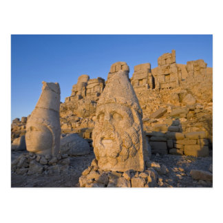 Colossal head statues of Gods guarding the Postcard