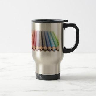 Coloured pencils in a rainbow travel mug