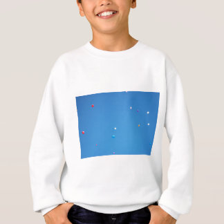 Colourful balloons released into a blue sky. sweatshirt