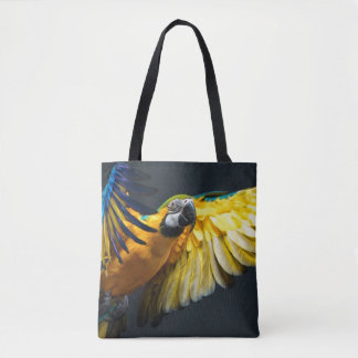 Colourful flying Ara on a dark background Tote Bag