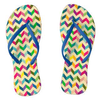 Colourful geometric chevron pattern flip flops