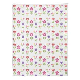 Colourful springtime flowers, on white duvet cover