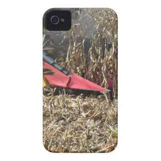 Combine harvesting corn crop in cultivated field iPhone 4 case