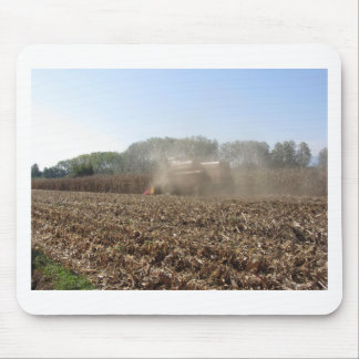 Combine harvesting corn crop in cultivated field mouse pad