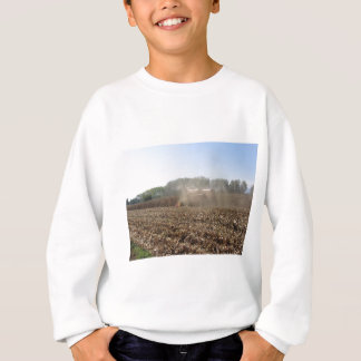 Combine harvesting corn crop in cultivated field sweatshirt