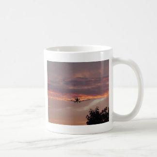 Commercial Jet Landing At Sunset Coffee Mug