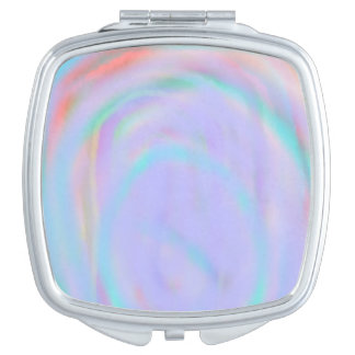 Compact mirror with a rainbow swirl pattern