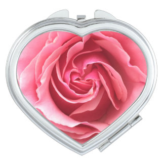 Compact with close up photo of pink rose vanity mirrors